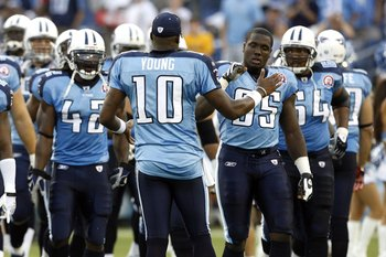 NASHVILLE, TN - AUGUST 15: Vince Young #10 of the Tennessee Titans shakes hands with William Hayes #95 before a game against the Tampa Bay Buccaneers during a preseason NFL game at LP Field on August 15, 2009 in Nashville, Tennessee. The Titans beat the B