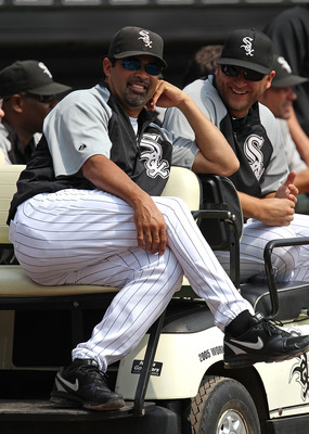 Ozzie Guillen relaxing with his workhorse lefty, Mark Buehrle.