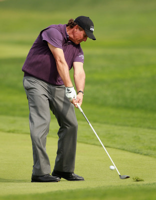 ABU DHABI, UNITED ARAB EMIRATES - JANUARY 23:  Phil Mickelson of the USA in action during the final round of The Abu Dhabi HSBC Golf Championship at Abu Dhabi Golf Club on January 23, 2011 in Abu Dhabi, United Arab Emirates.  (Photo by Andrew Redington/Ge