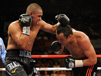 LAS VEGAS - JULY 31:  Juan Diaz (L) hits WBA/WBO lightweight champion Juan Manuel Marquez in the fifth round of their bout at the Mandalay Bay Events Center July 31, 2010 in Las Vegas, Nevada. Marquez retained his WBA and WBO lightweight championship belt