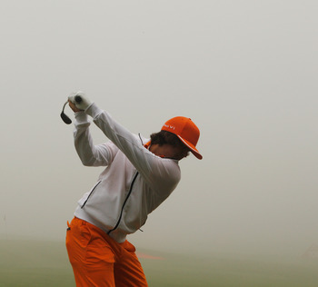 SHANGHAI, CHINA - NOVEMBER 07:  Rickie Fowler of the USA hits a shot on the practice ground during a fog delay in the final round of the HSBC Champions at the Sheshan Golf Club on November 7, 2010 in Shanghai, China.  (Photo by Scott Halleran/Getty Images