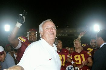 4 Oct 1997:  Head coach John Robinson of the USC Trojans celebrates his 100th win after a game against the UNLV Running Rebels at the Los Angeles Coliseum in Los Angeles, California.  USC won the game 35-21. Mandatory Credit: Jon Ferrey  /Allsport