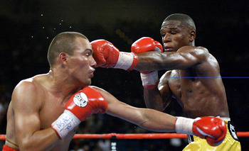 20 Apr 2002:   Floyd Mayweather (right) hits Jose Luis Castillo during the WBC Lightweight Championship at the MGM Grand Garden Arena in Las Vegas, Nevada.    DIGITAL IMAGE    Mandatory Credit: Jed Jacobsohn\\Getty Images