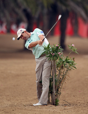 ABU DHABI, UNITED ARAB EMIRATES - JANUARY 20:  Padraig Harrington of Ireland during the first round of the Abu Dhabi HSBC Golf Championship at the Abu Dhabi Golf Club on January 20, 2011 in Abu Dhabi, United Arab Emirates.  (Photo by Ross Kinnaird/Getty I