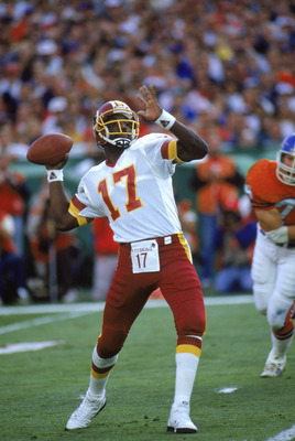 SAN DIEGO - JANUARY 31:  Quarterback Doug Williams #17 of the Washington Redskins looks to pass during Super Bowl XXII against the Denver Broncos at Jack Murphy Stadium on January 31, 1988 in San Diego, California.  The Redskins won 42-10.  (Photo by Bud