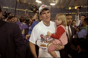 Jan 26, 1992:  Quarterback Mark Rypien of the Washington Redskins holds his daughter after Super Bowl XXVI against the Buffalo Bills at the Hubert Humphrey Metrodome in Minneapolis, Minnesota.  The Redskins defeated the Bills 37-24. Mandatory Credit: Rick