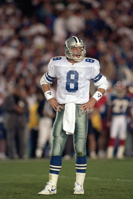PASADENA, CA - JANUARY 31:  Quarterback Troy Aikman #8 of the Dallas Cowboys looks over to the sidelines during Super Bowl XXVII against the Buffalo Bills at the Rose Bowl on January 31, 1993 in Pasadena, California.  The Cowboys won 52-17.  (Photo by Geo