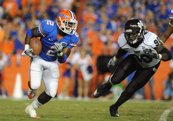 GAINESVILLE, FL - OCTOBER 16:  Running back Jeff Demps #2 of the Florida Gators rushes upfield against the Mississippi State Bulldogs October 16, 2010 Ben Hill Griffin Stadium at Gainesville, Florida.  (Photo by Al Messerschmidt/Getty Images)
