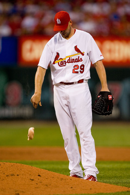 ST. LOUIS - JULY 15:  Starting pitcher Chris Carpenter #29 of the St. Louis Cardinals reacts to giving up a home run against the Los Angeles Dodgers at Busch Stadium on July 15, 2010 in St. Louis, Missouri.  (Photo by Dilip Vishwanat/Getty Images)