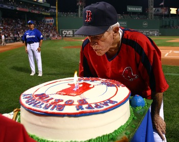 BOSTON - SEPTEMBER 27:  Red Sox legend Johnny Pesky blows out the candles on his birthday cake before the Boston Red Sox take on the Minnesota Twins on September 27, 2007 at Fenway Park in Boston, Massachusetts. The Red Sox honored Pesky's 88th birthday i
