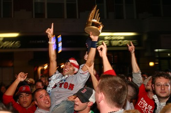 BOSTON - OCTOBER 29:  Fans celebrate on Brookline Avenue near Fenway Park after the Boston Red Sox defeated the Colorado Rockies 4-3 in Game Four of the World Series on October 29, 2007 in Boston, Massachusetts. The Red Sox swept the Rockies in four games