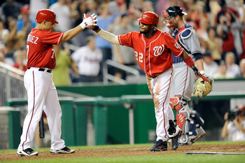 WASHINGTON - SEPTEMBER 24:  Willie Harris #22 of the Washington Nationals celebrates with Ivan Rodriguez #7 after hitting an inside the park home run in the seventh inning against the Atlanta Braves at Nationals Park on September 24, 2010 in Washington, D