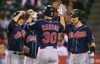 ANAHEIM, CA - SEPTEMBER 07:  (L-R) Trevor Crowe #4, Lou Marson #30 and Jason Donald #16 of the Cleveland Indians celebrate Marson's grand slam home run in the sixth inning against the Los Angeles Angels of Anaheim at Angel Stadium on September 7, 2010 in