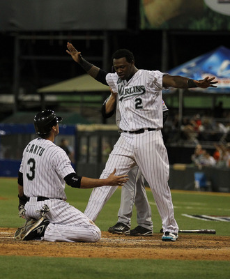 SAN JUAN, PUERTO RICO - JUNE 29:  Jorge Cantu #3 and Hanley Ramirez #2 of the Florida Marlins celebrate after Cantu scored the winning run off of a hit by Dan Uggla #6 as Rod Barajas #21 of the New York Mets is late with the tag in the bottom of the ninth