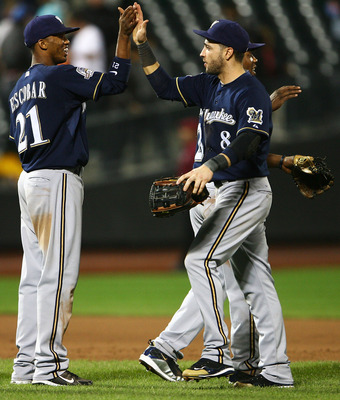 NEW YORK - SEPTEMBER 30:  Alcides Esobar #21 and Ryan Bauer #8 of the Milwaukee Brewers celebrate after beating the New York Mets 9 - 2 on September 30, 2010 at Citi Field in the Flushing neighborhood of the Queens borough of New York City. This was the f