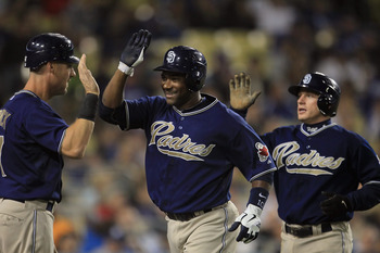LOS ANGELES, CA - SEPTEMBER 22:  (L-R) Ryan Ludwick #47, Miguel Tejada #10 and David Eckstein #22 of the San Diego Padres celebrate Tejada's two-run home run in the third inning against the Los Angeles Dodgers at Dodger Stadium on September 22, 2010 in Lo