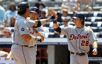 NEW YORK - AUGUST 19:  Miguel Cabrera #24 of the Detroit Tigers celebrates his first inning two run home run against the New York Yankees with teammates Johnny Damon #18 and Will Rhymes #28 on August 19, 2010 at Yankee Stadium in the Bronx borough of New