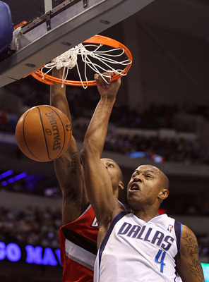 DALLAS, TX - DECEMBER 15:  Forward Caron Butler #4 of the Dallas Mavericks makes a slam dunk against Dante Cunningham #33 of the Portland Trail Blazers at American Airlines Center on December 15, 2010 in Dallas, Texas.  NOTE TO USER: User expressly acknow