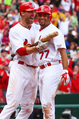 ST. LOUIS - OCTOBER 2: Joe Mather #22 and Pedro Feliz #77 both of the St. Louis Cardinals celebrate Feliz's game-winning run against the Colorado Rockies at Busch Stadium on October 2, 2010 in St. Louis, Missouri.  The Cardinals beat the Rockies 1-0 in 11