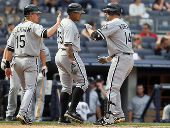 NEW YORK - MAY 02:  Paul Konerko #14 of the Chicago White Sox celebrates his ninth inning three run home run against the New York Yankees with teammates Andruw Jones #25 and Gordon Beckham #15 on May 2, 2010 at Yankee Stadium in the Bronx borough of New Y