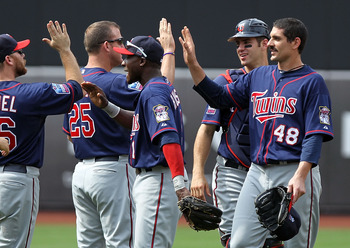 NEW YORK - JUNE 26:  Carl Pavano #48 of the Minnesota Twins celebrates the win with teammates against the New York Mets at Citi Field on June 26, 2010 in the Flushing neighborhood of the Queens borough of New York City.  (Photo by Nick Laham/Getty Images)