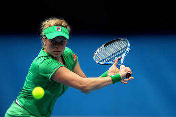 MELBOURNE, AUSTRALIA - JANUARY 26:  Kim Clijsters of Belgium plays a backhand in her quarterfinal match against Agnieszka Radwanska of Poland during day ten of the 2011 Australian Open at Melbourne Park on January 26, 2011 in Melbourne, Australia.  (Photo