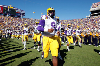 BATON ROUGE, LA - NOVEMBER 06:  Quarterback Jordan Jefferson #9 of the Louisiana State University Tigers runs onto the field during pregame before playing the Alabama Crimson Tide  at Tiger Stadium on November 6, 2010 in Baton Rouge, Louisiana.  (Photo by