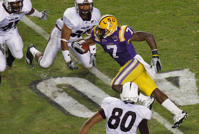 BATON ROUGE, LA - NOVEMBER 13:  Patrick Peterson #7 of the Louisiana State University Tigers runs through the defense of the University of Louisiana-Monroe Warhawks at Tiger Stadium on November 13, 2010 in Baton Rouge, Louisiana.   The Tigers defeated the