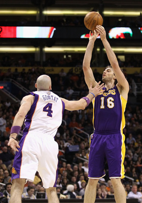 PHOENIX, AZ - JANUARY 05:  Pau Gasol #16 of the Los Angeles Lakers puts up a shot against the Phoenix Suns during the NBA game at US Airways Center on January 5, 2011 in Phoenix, Arizona. The Lakers defeated the Suns 99-95.  NOTE TO USER: User expressly a