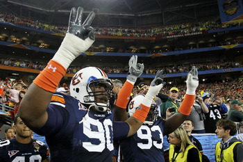GLENDALE, AZ - JANUARY 10:  Nick Fairley #90 of the Auburn Tigers and Mike Blanc #93 of the Auburn Tigers show their support against the Oregon Ducks during the Tostitos BCS National Championship Game at University of Phoenix Stadium on January 10, 2011 i