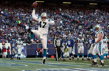 EAST RUTHERFORD, NJ - DECEMBER 27:  Jeff King #47 of the Carolina Panthers celebrates his second quarter touchdown against the New York Giants at Giants Stadium on December 27, 2009 in East Rutherford, New Jersey.  (Photo by Nick Laham/Getty Images)
