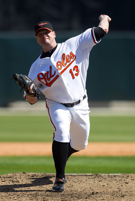 SARASOTA, FL - MARCH 07:  Pitcher Will Ohman #13 of the Baltimore Orioles pitches against the Boston Red Sox during a Grapefruit League Spring Training Game at Ed Smith Stadium on March 7, 2010 in Sarasota, Florida.  (Photo by J. Meric/Getty Images)