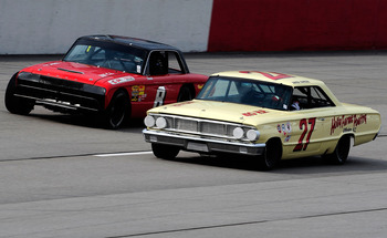 DARLINGTON, SC - SEPTEMBER 26:  Vintage stock cars drive during the Darlington Historic Racing Festival at Darlington Raceway on September 26, 2010 in Darlington, South Carolina.  (Photo by Rusty Jarrett/Getty Images)
