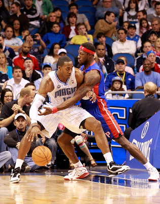 ORLANDO, FL - JANUARY 24:  Ben Wallace #6 of the Detroit Pistons guards Dwight Howard #12 of the Orlando Magic during the game at Amway Arena on January 24, 2011 in Orlando, Florida.  NOTE TO USER: User expressly acknowledges and agrees that, by downloadi