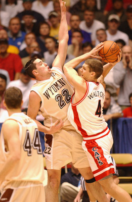 16 Mar 2002:  Luke Walton #4 of Arizona fights for position against Josh Davis #22 of Wyoming in a 68-60 win during the second round of the NCAA Men's Baketball Tournament at The Pit in Albuquerque, New Mexico. DIGITAL IMAGE. Mandatory Credit: Harry How/G