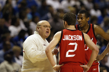 NASHVILLE, TN- MARCH 23:  Head coach Rick Majerus of Utah talks to Marc Jackson #2 and Bryant Markson #20 during a time out against Kentucky in the second round of the NCAA Mens Basketball Championship on March 23, 2003 at the Gaylord Entertainment Center
