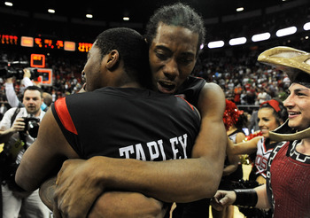 LAS VEGAS - MARCH 13:  Kawhi Leonard #15 of the San Diego State Aztecs hugs teammate Chase Tapley #22 as they celebrate on the court after defeating the UNLV Rebels 55-45 in the championship game of the Conoco Mountain West Conference Basketball tournamen