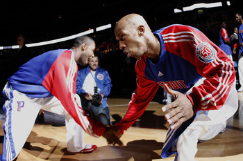 AUBURN HILLS, MI - MAY 05:  Chauncey Billups #1 of the Detroit Pistons low fives Rodney Stucky #5 during team introductions prior to playing the Orlando Magic in Game Two of the Eastern Conference Semifinals during the 2008 NBA Playoffs at the Palace of A