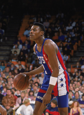 LOS ANGELES - 1990:  Dennis Hopson #2 of the New Jersey Nets dribbles the ball as Byron Scott #4 of the Los Angeles Lakers defends during the NBA game at the Great Western Forum in Los Angeles, California in 1990. NOTE TO USER: User expressly acknowledges