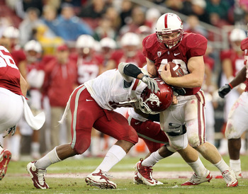 PALO ALTO, CA - OCTOBER 23:  Owen Marecic #48 of the Stanford Cardinal is tackled by C.J. Mizell #12 of the Washington State Cougars at Stanford Stadium on October 23, 2010 in Palo Alto, California.  (Photo by Ezra Shaw/Getty Images)