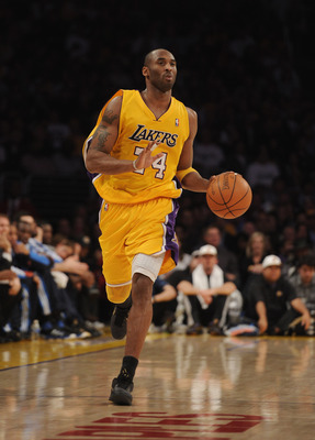 LOS ANGELES, CA - JANUARY 17:  Kobe Bryant #24 of the Los Angeles Lakers dribbles up court during the game against the Oklahoma City Thunder at the Staples Center on January 17, 2011 in Los Angeles, California.  (Photo by Harry How/Getty Images)   NOTE TO