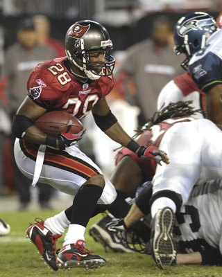 TAMPA, FL - OCTOBER 19: Running back Warrick Dunn #28 of the Tampa Bay Buccaneers plays against the Seattle Seahawks at Raymond James Stadium on October 19, 2008 in Tampa, Florida.  (Photo by Al Messerschmidt/Getty Images)