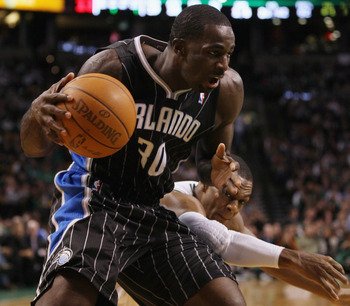 BOSTON, MA - JANUARY 17:   Brandon Bass #30 of the Orlando Magic tries to keep the ball as Rajon Rondo #9 of the Boston Celtics defends on January 17, 2011 at the TD Garden in Boston, Massachusetts. The Celtics defeated the Magic 109-106.  NOTE TO USER: U