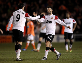BLACKPOOL, ENGLAND - JANUARY 25:  Ryan Giggs of Manchester United celebrates with team mate Dimitar Berbatov (L) at the end of the Barclays Premier League match between Blackpool and Manchester United at Bloomfield Road on January 25, 2011 in Blackpool, E