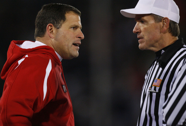 EAST HARTFORD, CT - NOVEMBER 3:  Coach Greg Schiano (L) of the Rutgers Scarlet Kinghts has words with an official during a game against the University of Connecticut Huskies at Rentschler Field November 3, 2007 in East Hartford, Connecticut.  (Photo by Ji