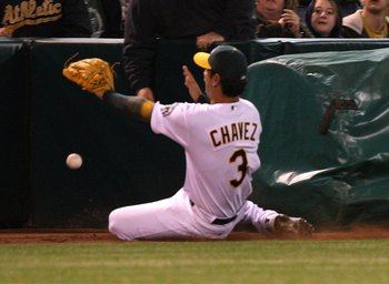 OAKLAND, CA - APRIL 10:  Eric Chavez #3 of the Oakland Athletics misses a foul ball against the Seattle Mariners during Opening Day at a Major League Baseball game on April 10, 2009 at the Oakland Coliseum in Oakland, California.  (Photo by Jed Jacobsohn/