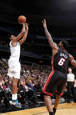 WASHINGTON, DC - DECEMBER 18:  Nick Young #1 of the Washington Wizards shoots over Lebron James #6 of the Miami Heat at the Verizon Center on December 18, 2010 in Washington, DC. NOTE TO USER: User expressly acknowledges and agrees that, by downloading an
