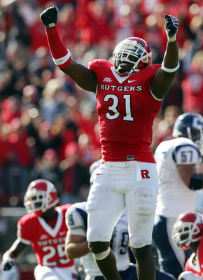 PISCATAWAY, NJ - OCTOBER 18:  George Johnson #31 of the Rutgers Scarlet Knights celebrates a missed field goal by the Connecticut Huskies late in the game at Rutgers Stadium on October 18, 2008 in Piscataway, New Jersey. Rutgers defeated Connecticut 12-10