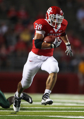 NEW BRUNSWICK, NJ - SEPTEMBER 02:  Joe Martinek #38 of the Rutgers Scarlet Knights runs the ball against the Norfolk State Spartans at Rutgers Stadium on September 2, 2010 in New Brunswick, New Jersey. The Scarlet Knights beat the Spartans 31 - 0.  (Photo