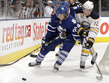 TORONTO - SEPTEMBER 27: Christian Hanson #20 of the Toronto Maple Leafs gets away from Luke Adam #72 of the Buffalo Sabres during a preseason NHL game at the Air Canada Centre September 27, 2010 in Toronto, Ontario, Canada. (Photo by Abelimages/Getty Imag